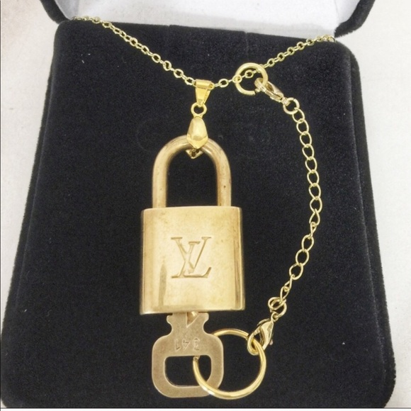 f1324239cb4e Louis Vuitton Jewelry - Louis Vuitton lock  key with a gold necklace
